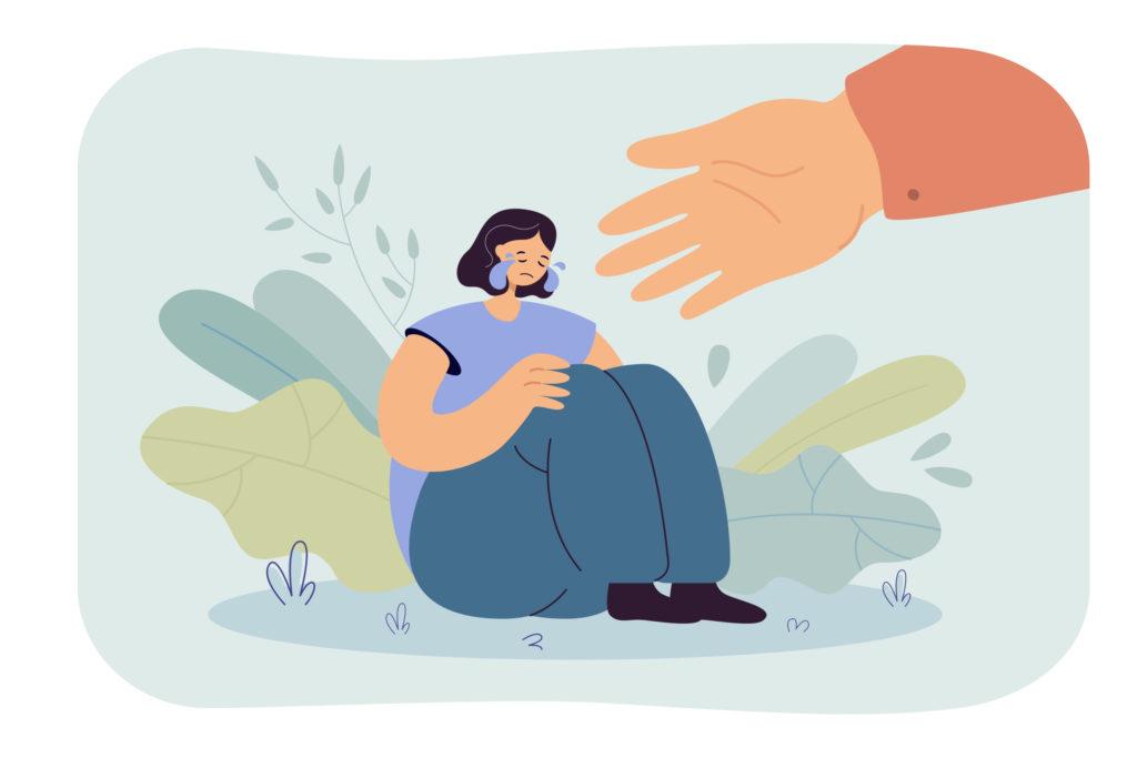 Piirroskuva itkevästä naisesta. Ison käden ojennus kuvaa työyhteisön tukea.